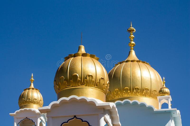 Sikh temple golden domes on the roof stock photos