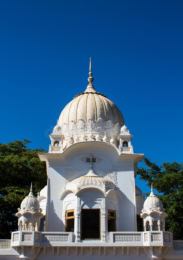 Sikh temple white dome stock photo