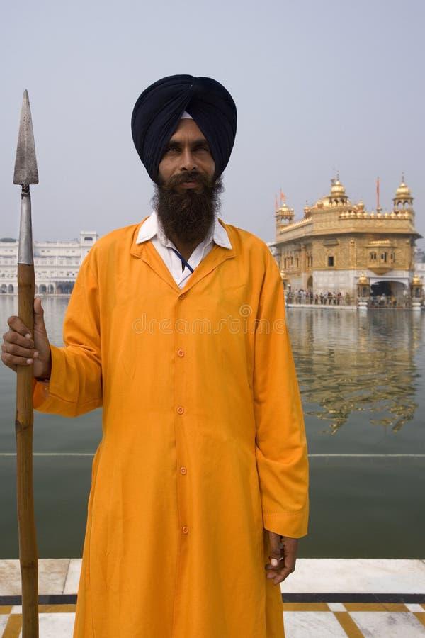 SikhGuard - guld- tempel - Amritsar - Indien arkivbilder