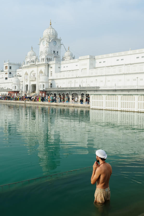 Sikhs prayer. Golden temple (Sri Harimandir Sahib) in Amritsar. It is a central religions place of the Sikhs royalty free stock image