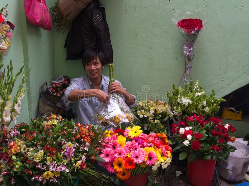 Sikkim Local people selling flowers in the market, Gangtok City,Sikkim INDIA , 16th APRIL 2013.  royalty free stock photos