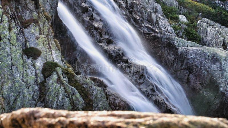 Siklawa waterfall close to the Five Polish Lakes Valley. In Tatra mountains range in Tatra National Park. Long exposure photo. Smokey water stock image