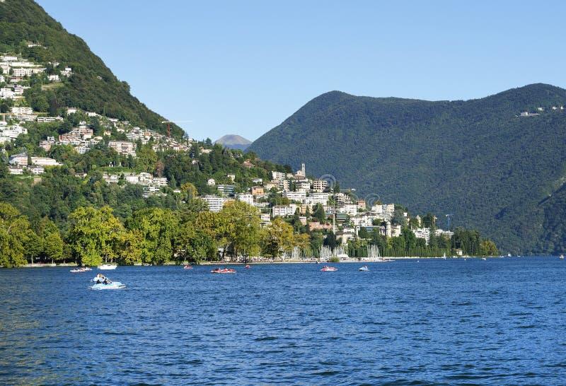 Sikt av sjön och staden av Lugano fotografering för bildbyråer