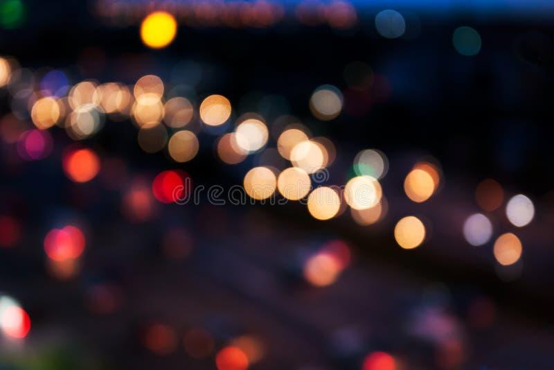 Sikt för bakgrund för suddighet för stads- och trafikljusbokehabstrakt begrepp från över royaltyfria bilder