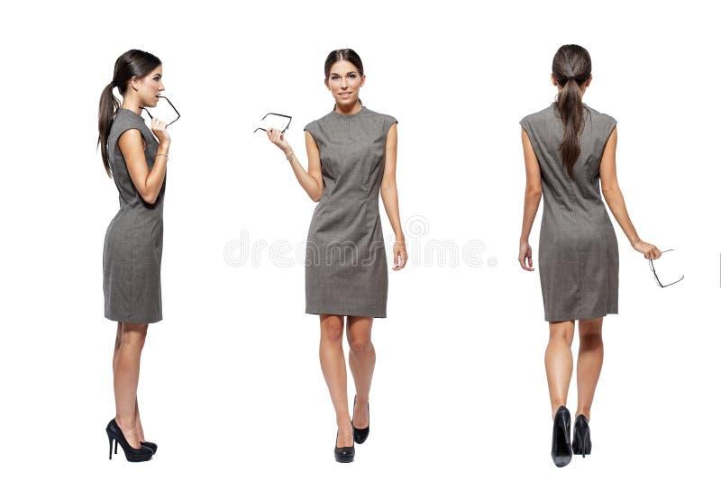 Sikt för baksida för främre sida för affärskvinna royaltyfri bild