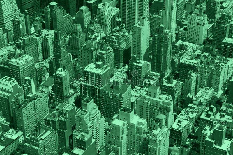 Sikt för kulöra byggnader för gräsplan flyg- i New York City fotografering för bildbyråer