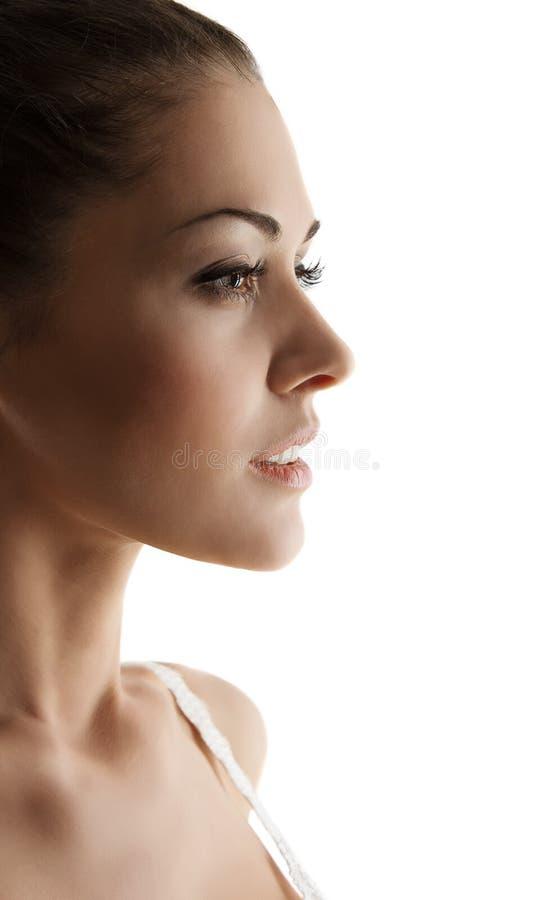 Sikt för kvinnaståendesida över vit bakgrund arkivbild