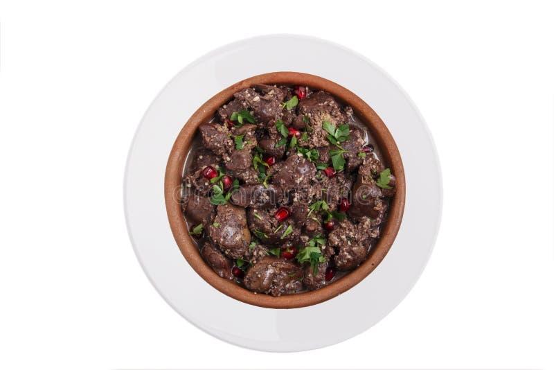 Sikt för traditionell georgisk bakgrund för maträtt för kuchmachi för höna för nötkött för stekhjärtalever bästa vit royaltyfri bild