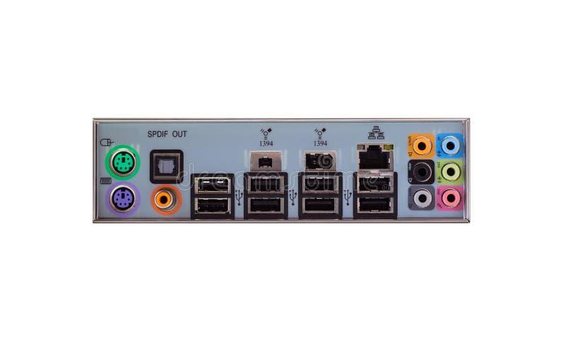 Sikt från baksidan av en skrivbords- dator med en synlig anslutningspanel, ljudsignal, LAN, mus, tangentbord, USB royaltyfria foton
