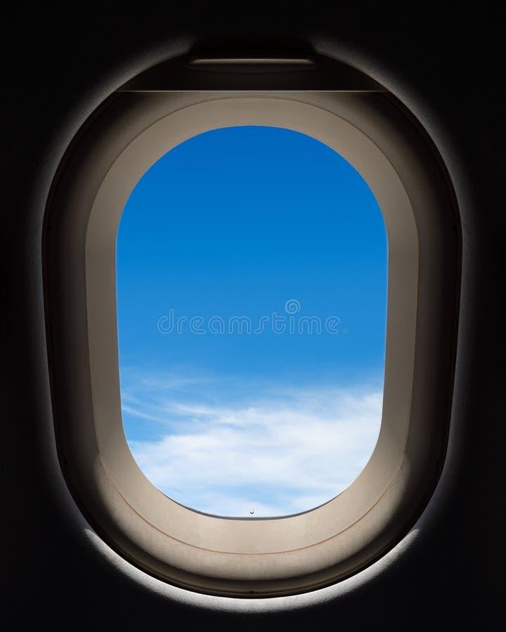 Sikt till och med ett flygplanf?nster royaltyfri fotografi