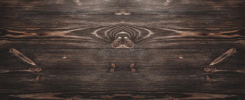 Sikten från ovannämnt av ett hårt trä, tid åldrades träbakgrund för gammal, lantlig mörk brunt arkivbild