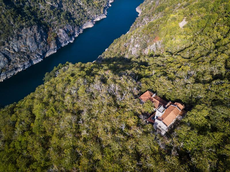 Sil river in the Ribeira Sacra in Galicia. Aerial view of Santa Cristina de Ribas de Sil in early Autumn, with the canyon of the river Sil acting as the natural stock image
