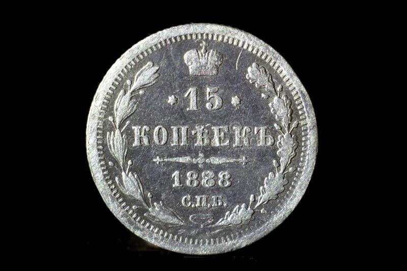 15 silberne Cents des russischen Reiches auf einem schwarzen lokalisierten Hintergrund lizenzfreies stockfoto