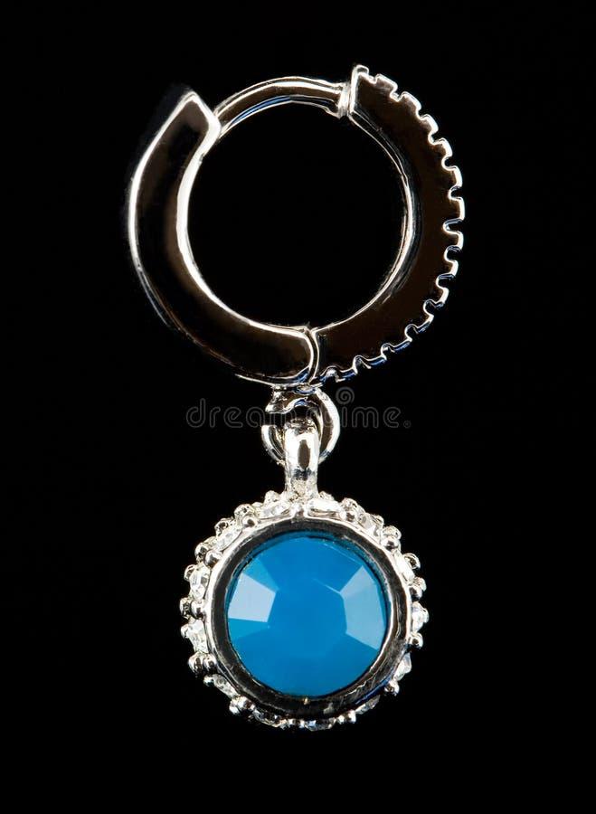 Silberne Ohrringe lizenzfreies stockfoto