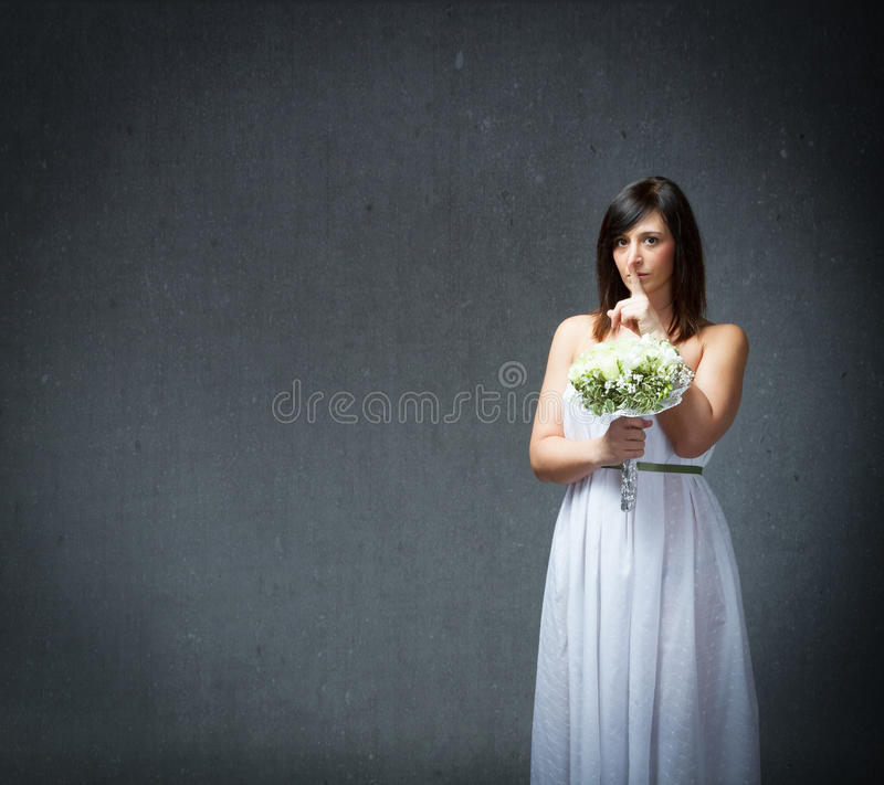 Silence in a marriage dress. People emotions and expressions in dark background stock photo