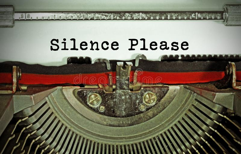Silence Please text written with an old typewriter stock photo