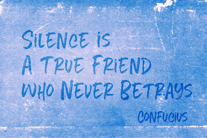 True friend Confucius. Silence is a true friend who never betrays - ancient Chinese philosopher Confucius quote printed on grunge blue paper royalty free illustration