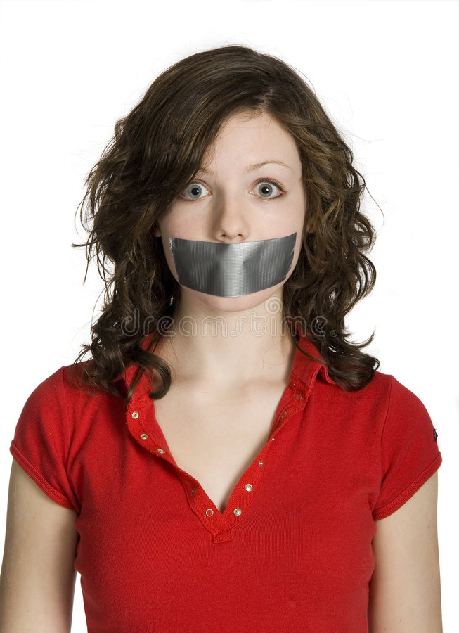 Silenced. Teen girl with mouth taped closed