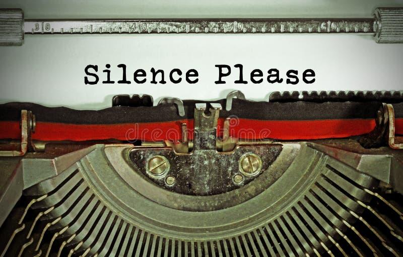 Silencie text por favor escrito com uma máquina de escrever velha foto de stock
