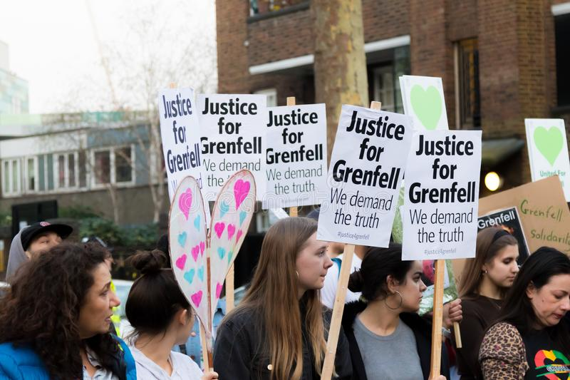 Silent March for Grenfell Tower in Kensington and Chelsea. London, United Kingdom, 14th April 2018:- Marchers on a silent march from Kensington Town Hall to the stock photo