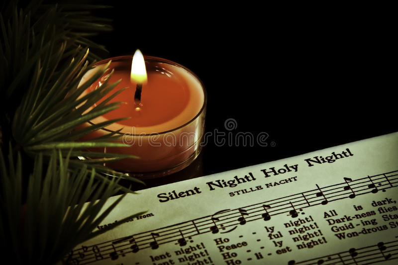 Silent Night. Sheet music with candle royalty free stock photography