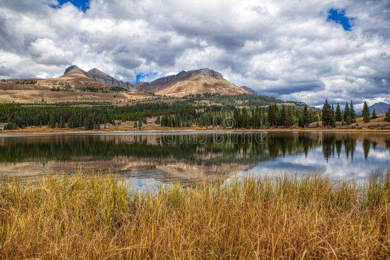 Lakeside view of Colorado Rocky Mountains near Durango. A silent pond near Colorado Rocky Mountains North of Durango CO stock image