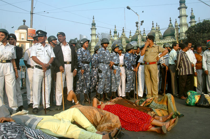 SILENT PROTEST. Protesters lying on the road in protesting against Singur land acquisition by Tata Motors, West Bengal , India Supporters of a political party in royalty free stock image
