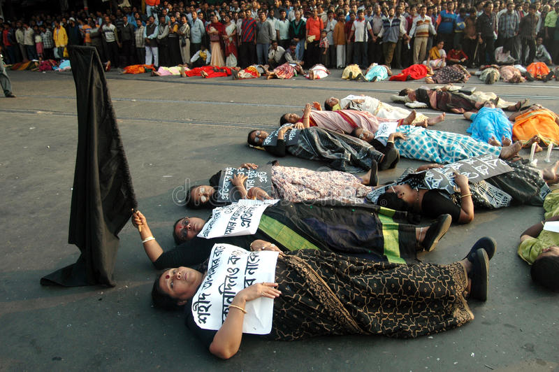 SILENT PROTEST. Protesters lying on the road in protesting against Singur land acquisition by Tata Motors, West Bengal , India. With a black flag in hand the royalty free stock photos