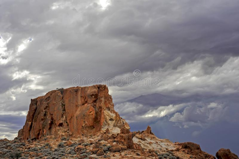 Silent soldier granite outcrop surrounded by storm clouds, out-back north western Australia. stock images