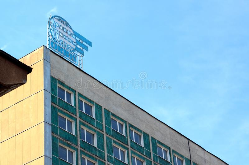 Silesia Hotel. Katowice, Poland - June 4, 2019: Neon sign `Orbis` on Hotel Silesia - previous workers` hostel -  during its demolition royalty free stock photos