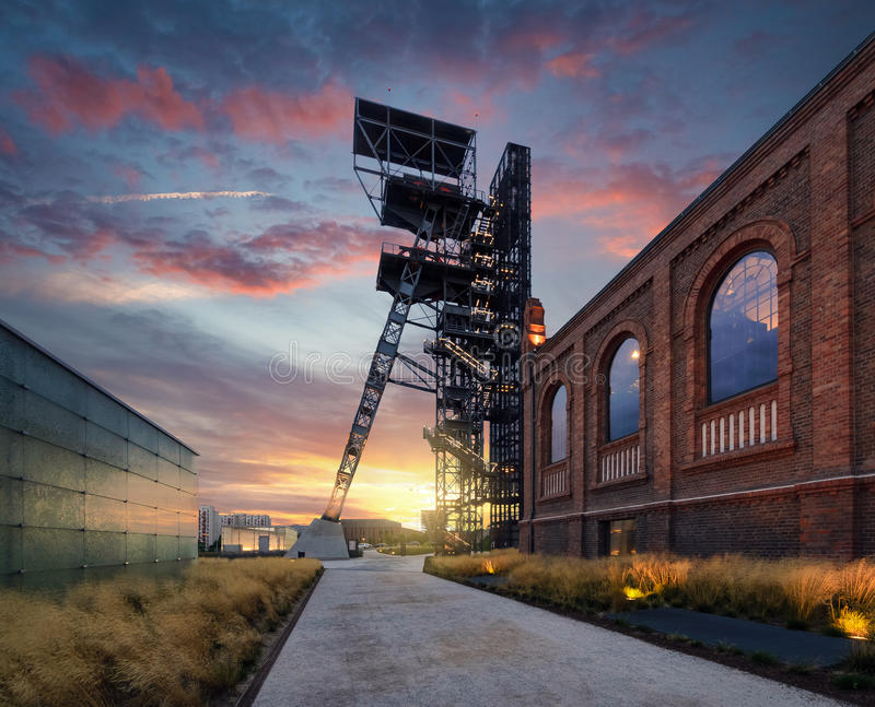 Silesian Museum during sunset. The former coal mine `Katowice`, seat of the Silesian Museum. The complex combines old mining buildings and infrastructure with stock photos