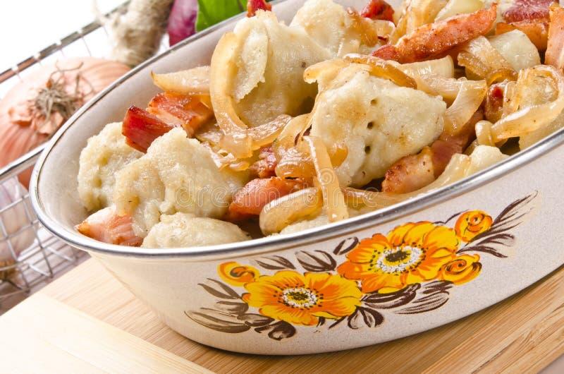 Silesian potato dumplings. With smoked pork and sauerkraut royalty free stock photography