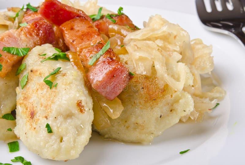 Silesian potato dumplings. With smoked pork and sauerkraut stock photos