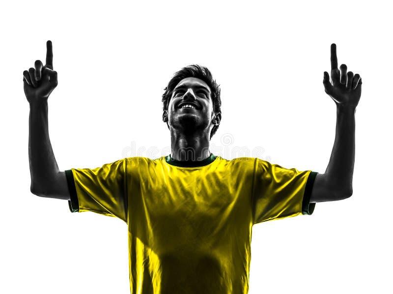 Silhoue för man för glädje för lycka för brasiliansk fotbollfotbollsspelare ung arkivfoto