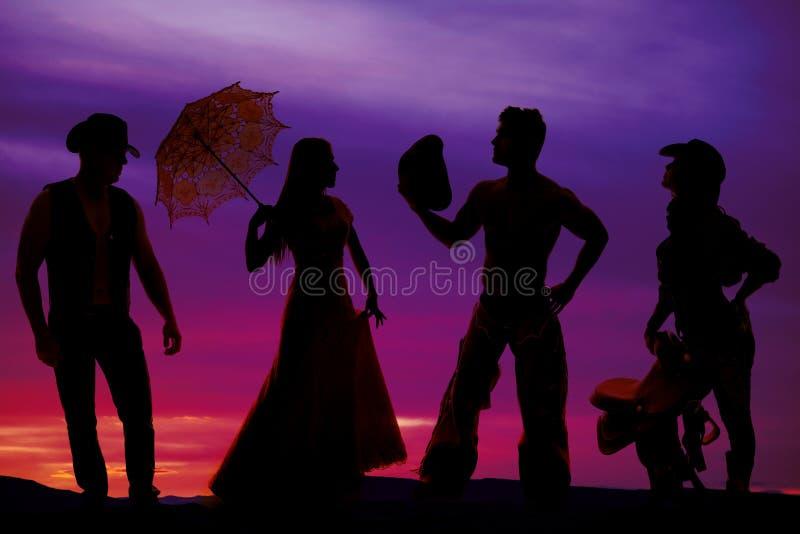 Silhouet van cowboys en vrouwen stock fotografie