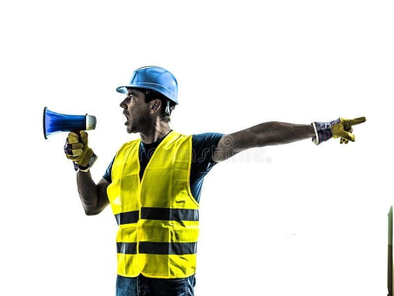 Silhouet van de bouwvakker het signalerende megafoon stock fotografie