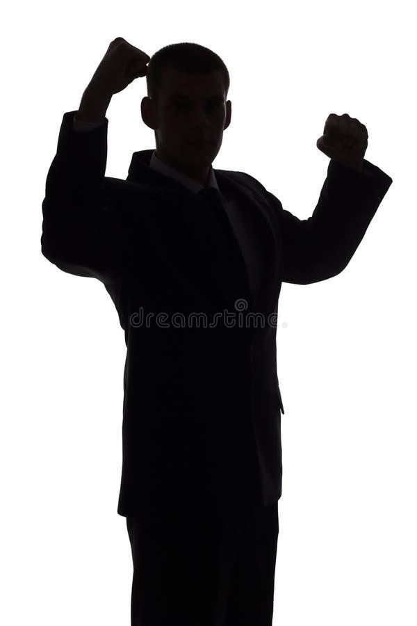Silhouet Van De Mens Met Omhoog Wapens Stock Fotografie
