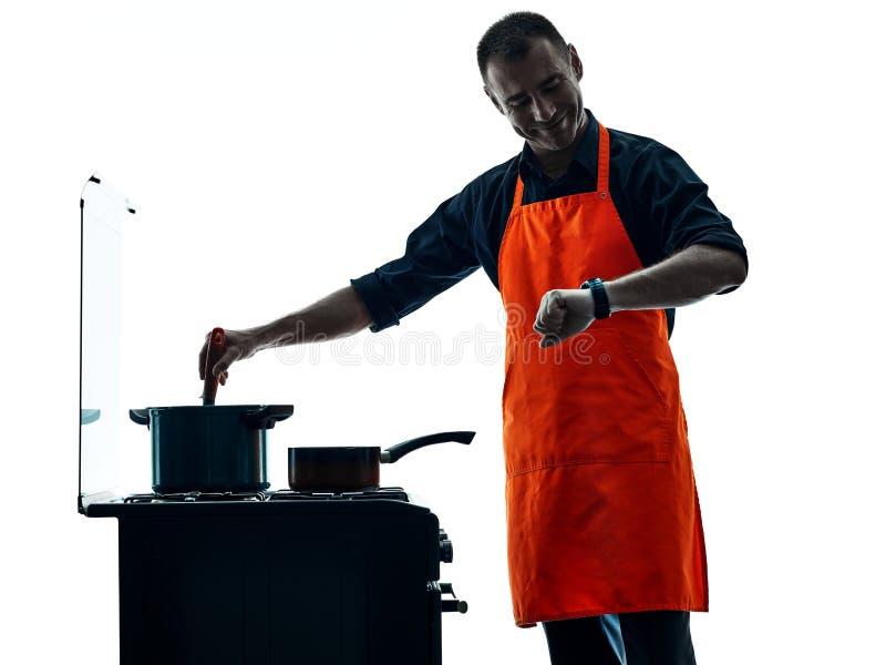 Silhouet van de mensen het kokende chef-kok stock foto