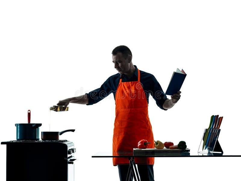 Silhouet van de mensen het kokende chef-kok royalty-vrije stock afbeeldingen