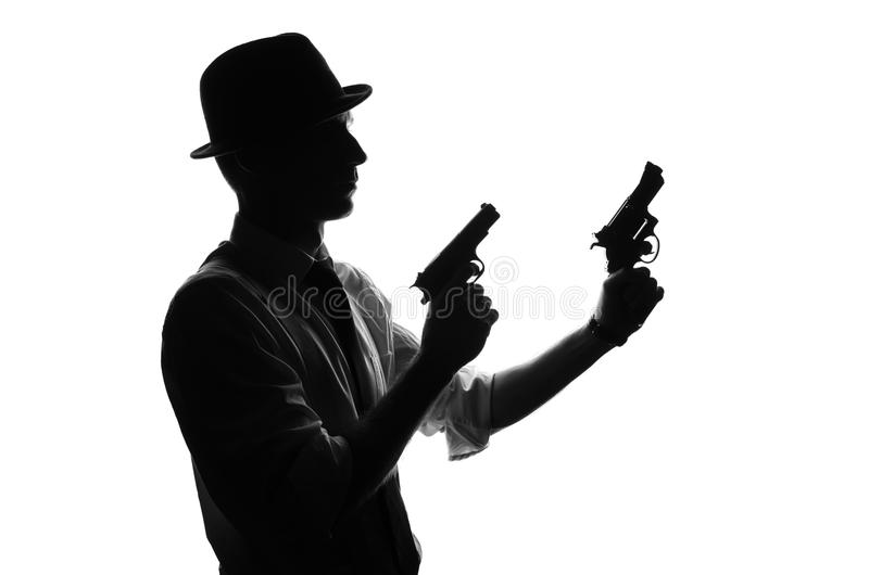 Silhouet van detective met twee kanonnen royalty-vrije stock afbeeldingen