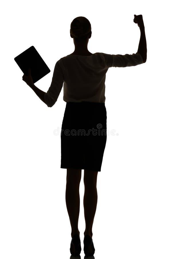 Silhouet van een bezige bedrijfsvrouwen backlight studio stock foto's