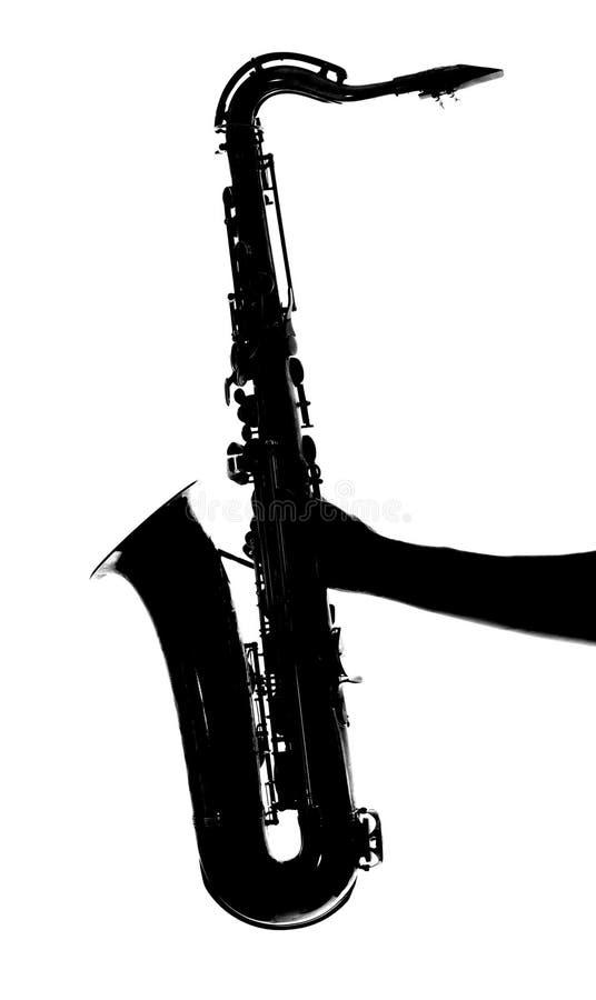 Silhouet van een man& x27; s hand die een saxofoon houden royalty-vrije illustratie
