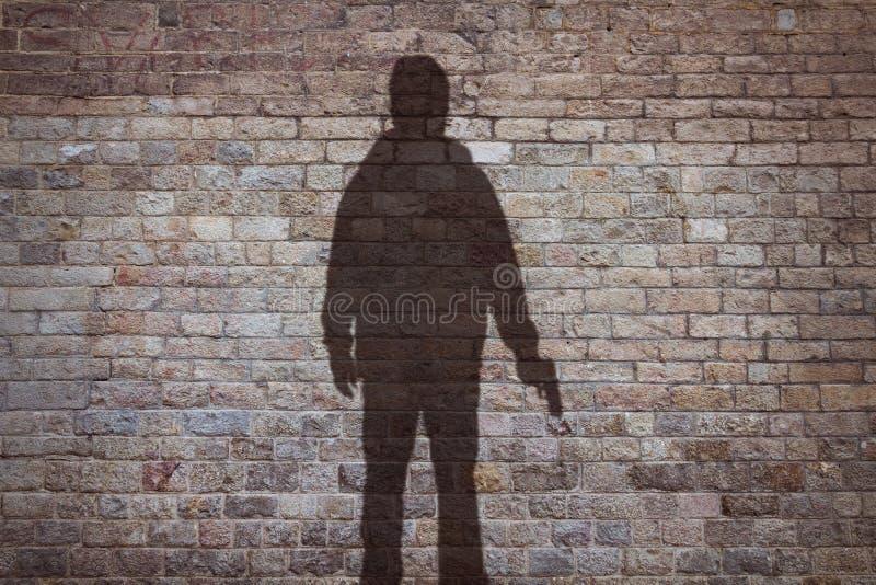 Silhouet van een mens met een kanon royalty-vrije stock afbeeldingen