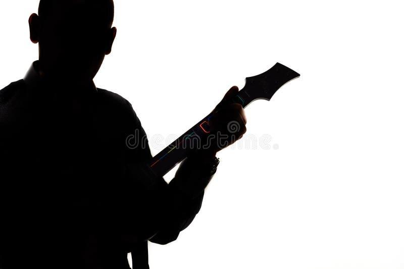 Silhouet van een mens met gitaar royalty-vrije stock afbeelding