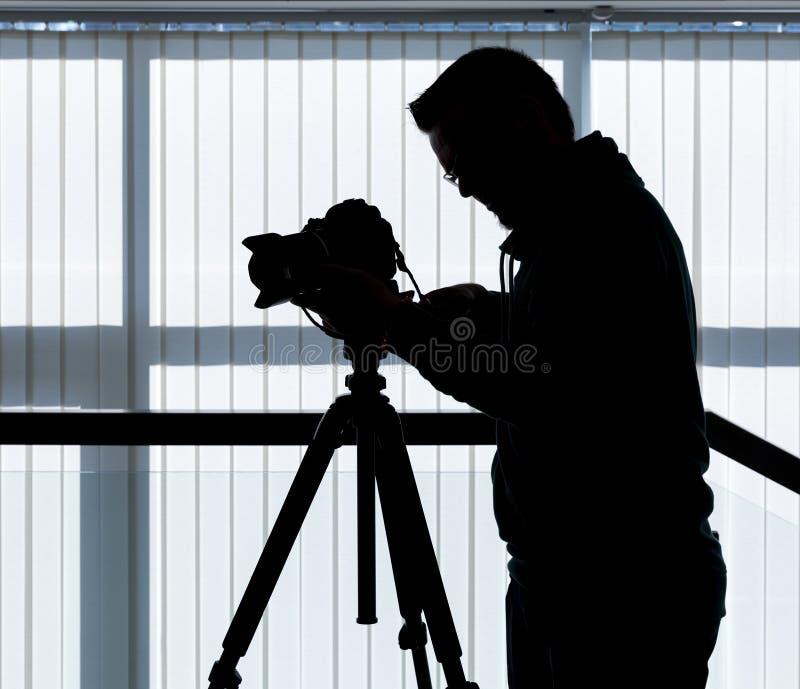 Silhouet van fotograaf en cameraman stock foto