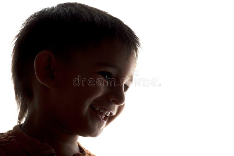 Silhouet van gelukkig het lachen kindgezicht royalty-vrije stock foto's