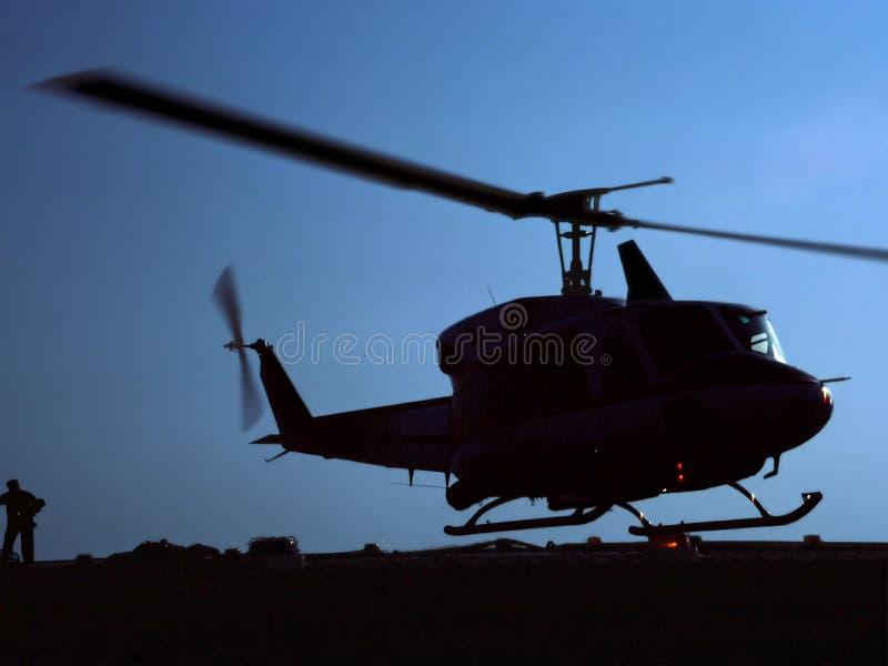 Silhouet van Helikopter het Landen stock fotografie