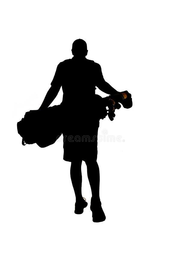 Silhouet van jonge golfspeler die met golfzak er vandoor gaat stock foto