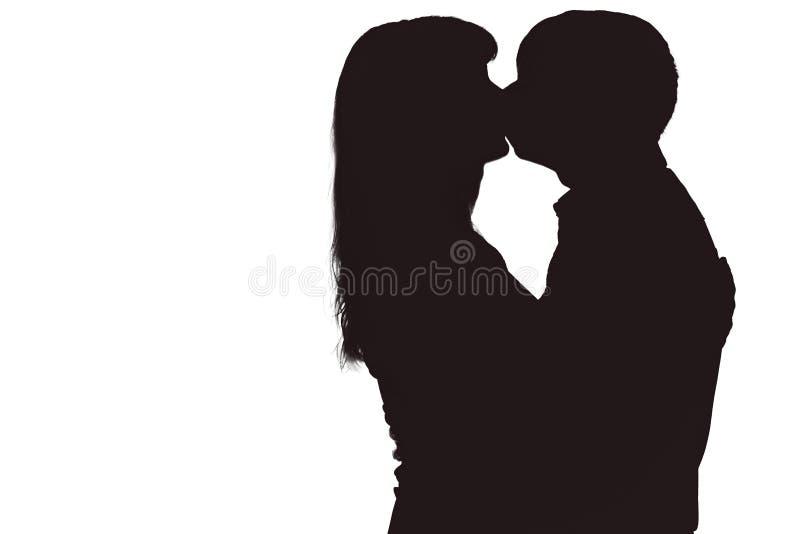 Silhouet van man en vrouwen het kussen royalty-vrije stock fotografie