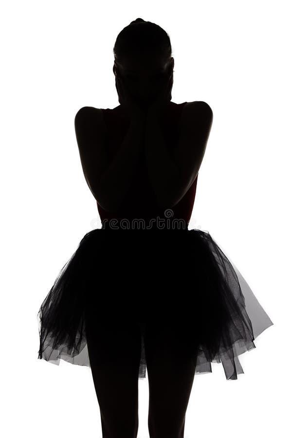 Silhouet van verrast dansersmeisje stock afbeelding